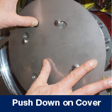 2. Push Down on Cover